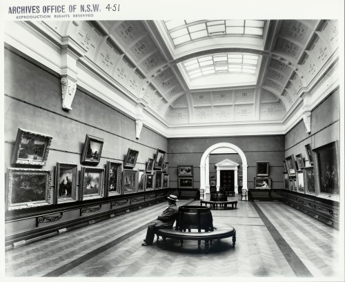 Man sitting in art gallery alone, circa late 1800s.
